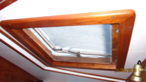 Hatch cover details solid teak framing with integral opening bug screen